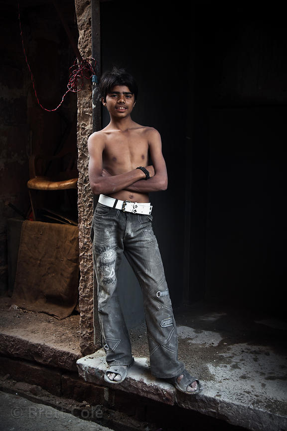 Boy at a butcher shop in Jodhpur, Rajasthan, India. Natural light, no flash or computer manipulation.