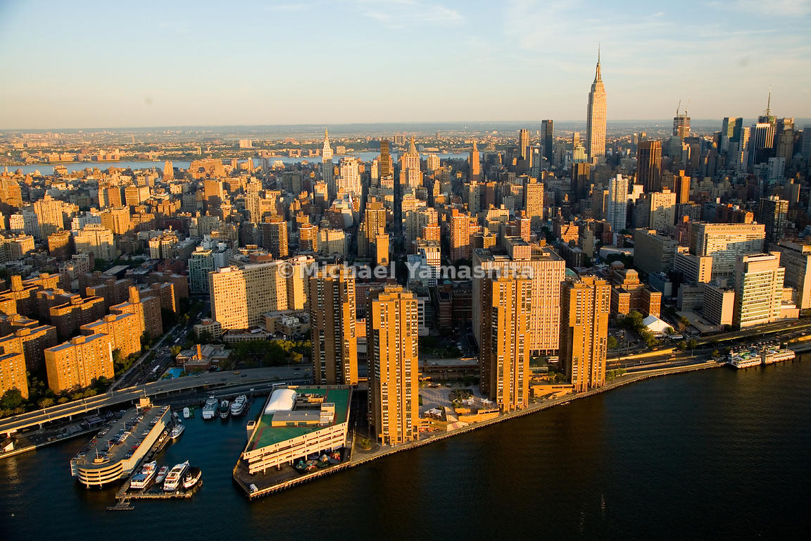 The four red-brick apartment towers of Waterside Plaza are built on a platform over the East River. On the southern tip is th...
