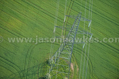 Aerial view of electric pylons through countryside, Hertfordshire