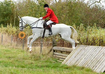 Nicholas Leeming jumping a hunt jump near Peake's. The Cottesmore Hunt at Somerby