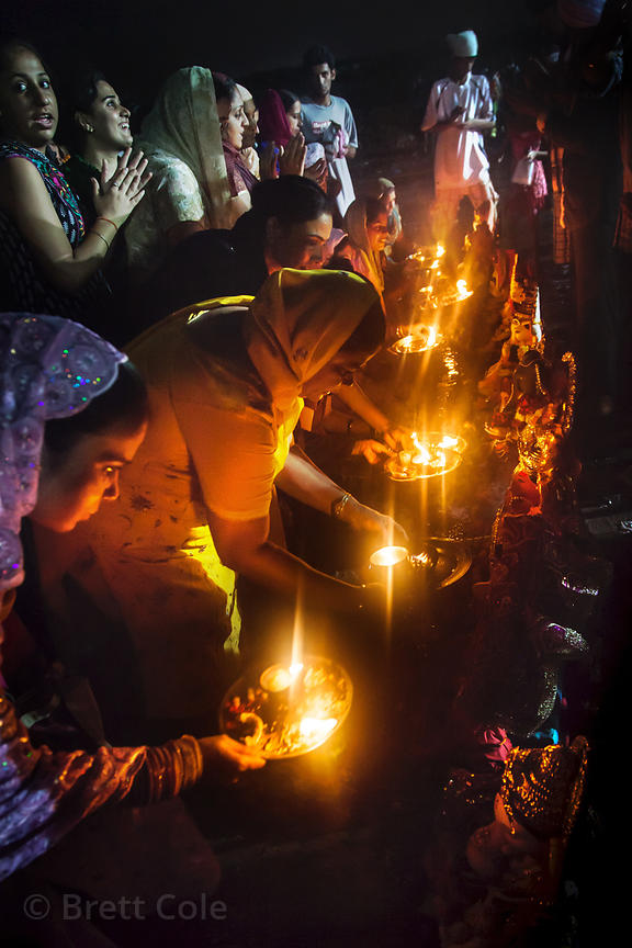 A family performs rituals on Chowpatty Beach during the Ganesh Chaturthi festival in Mumbai, India.