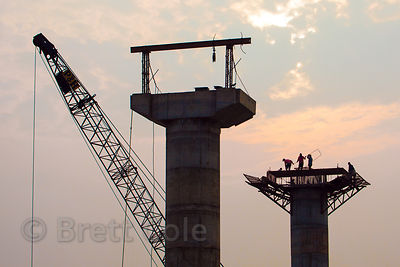 Men work to build a new bridge across the Ganges River from Varanasi to Ramnagar, India.