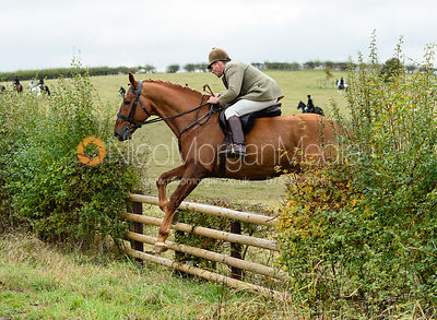Bruce McKim jumping onto Bruce's Lane. The Cottesmore Hunt at Somerby