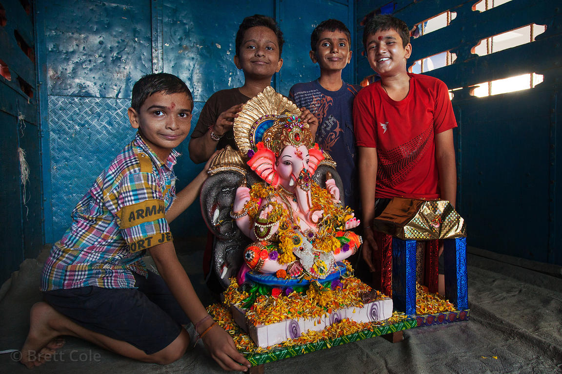 A family loads their Ganpati (Ganesh idol) on a truck, in preparation to immerse it in the Arabian Sea at Chowpatty Beach, Mu...