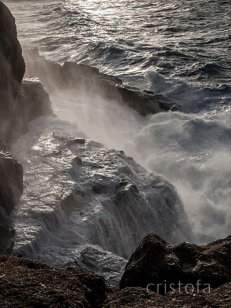 waves crashing on the cliffs west of Sennen