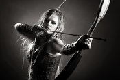 Woman archer aiming arrow