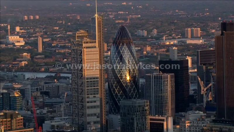 Aerial footage around The City of London at dusk, London, England, UK
