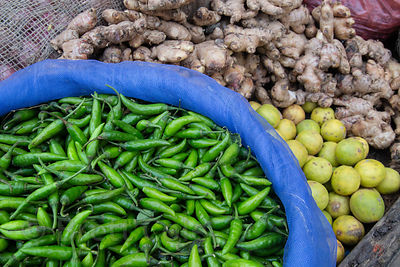 Peppers and lemons for sale at a market. The two are used together as a good luck charm by Hindus. Birdopur, Varanasi, India.