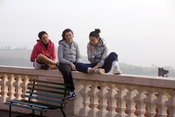 Italy - Bologna - Teenage girls sit atop a balcony at the Santuario della Madonna di Santa Luca