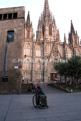 Woman tourist in a wheelchair in Barcelona, Spain