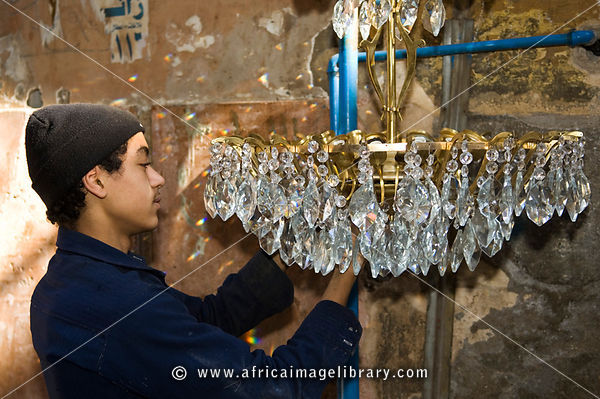 Boy making a chandelier, Streetscene, Alexandria, Egypt