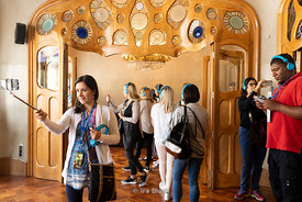 Tourists taking selfies inside Casa Batlló, an architectural masterpiece by Antoni Gaudí in Barcelona, Spain.