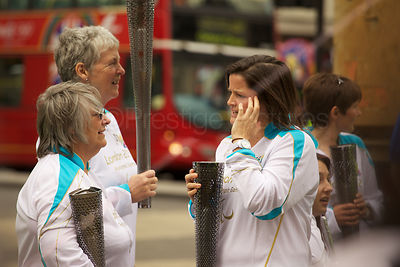 Paralympic Torch Bearers wait at Oxford Circus