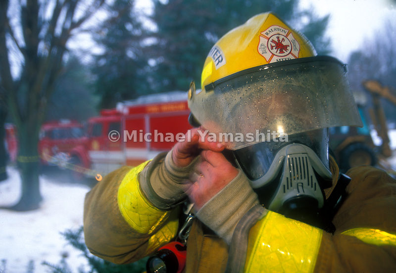 Fireman removing his fire helmet,