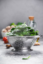 Spinach. Fresh organic spinach leaves in metal colander and healthy ingredients. Diet, dieting concept. Vegan food, healthy e...
