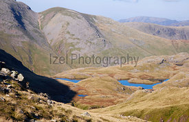 Views of Sprinking Tarn near the shadows of Great End in the English Lake District. UK.