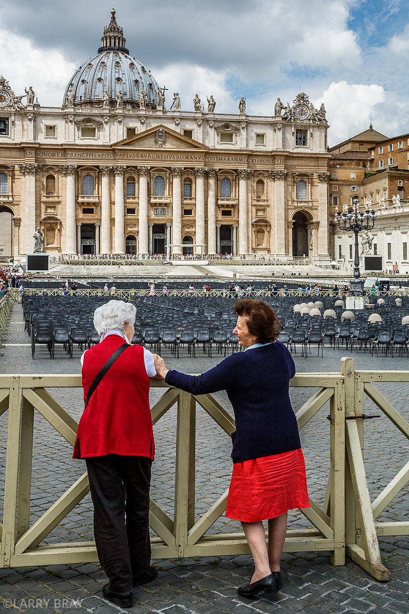 Two Italian women chatting in front of St Peters Basilica, the Vatican, Rome Italy