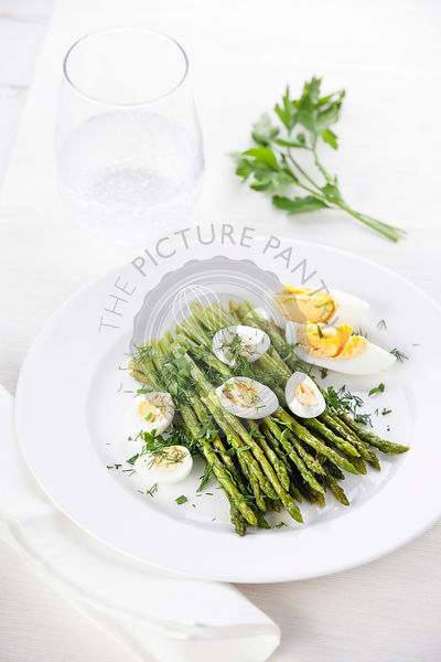 Salad with asparagus and eggs on white
