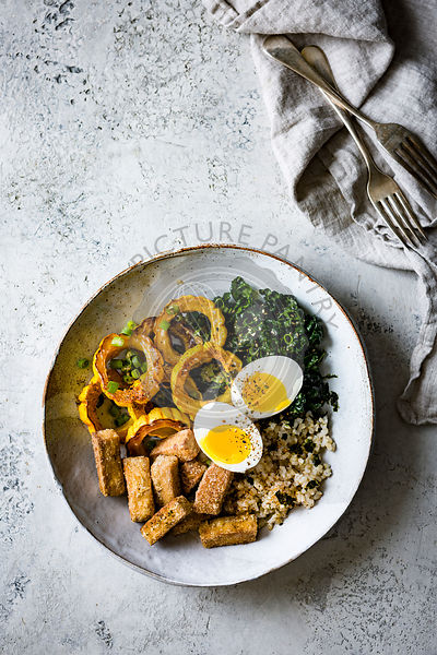 A savoury Winter Squash, Kale, Tofu Rice Bowl