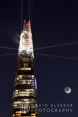 Lightshow at the top of The Shard with the Waxing Cresent Moon