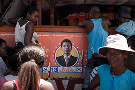 Residents of Fort Dauphin line up in front of the headquarters of supporters of Madagascar's presidential candidate Andry Raj...