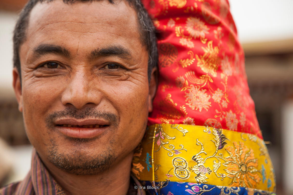 A man at Chimi Lhakhang, also known as Chime Lhakhang or Monastery, in Punakha District, Bhutan.