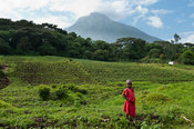 Child in front of Volcano Mount Mikeno, Virunga National Park, DR Congo