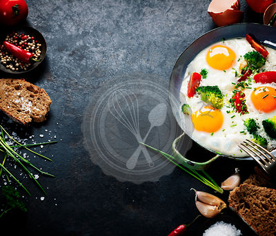 Pan of fried eggs, broccoli and cherry-tomatoes with bread on old metal background, top view