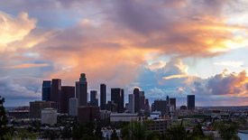 Medium Shot: Rare Cumulo-Numbus Clouds Dominating A Colorful Sunset Over Downtown L.A. (Day To Night)