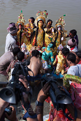 Hindu families immerse idols of the Goddess Durga into the Hooghly River at Babughat, during the Durga Puja festival, Kolkata...