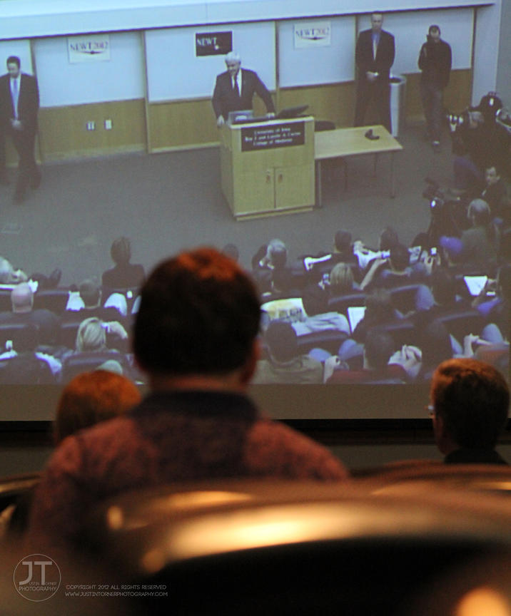 Onlookers watch a video feed of Newt Gingrich's speech in an overflow room adjacent to the room where he was speaking on the ...