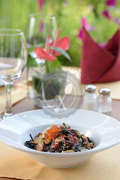 Seafood Ink spaghetti serve with table setup