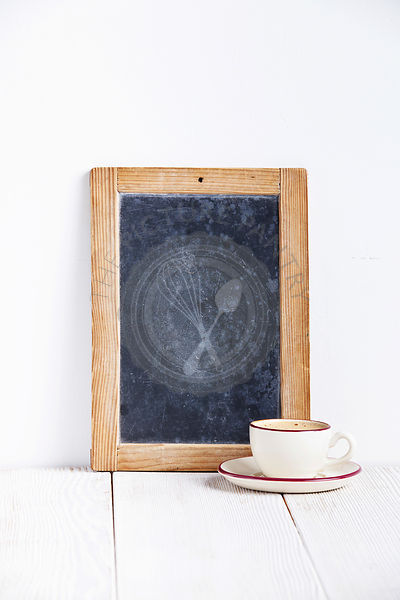 Coffee cup with vintage slate chalk board