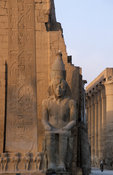 25m high obelisk and colossal statue of Rameses II on his throne in the Temple of Luxor, Luxor, Egypt