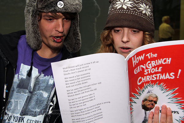 Occupy protesters Dakota Jolly and Jenah Vail sing modified Christmas carols outside of the Medical Education and Research Fa...