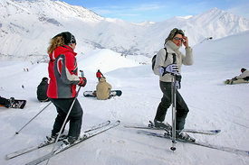 Young girls and boys from Teheran ignore the fact that skiing in the modern ski slopes in Dizin is strictly regulated. Women ...