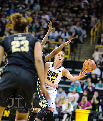 Iowa's Kali Peschel (25) passes around a Purdue defender during the second half of play at Carver-Hawkeye Arena in Iowa City ...