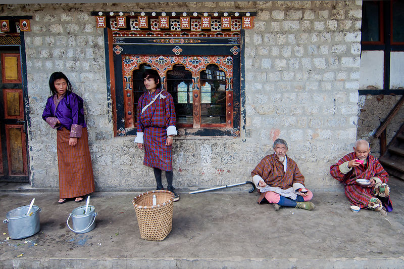 An everyday scene at any Bhutanese street. A Young couple try to sell their goods while the old men rest. This photograph was...