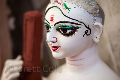 Durga Puja idols at a workshop in Kumartoli, Kolkata, India. The idols are said to come alive when the eyes are painted.