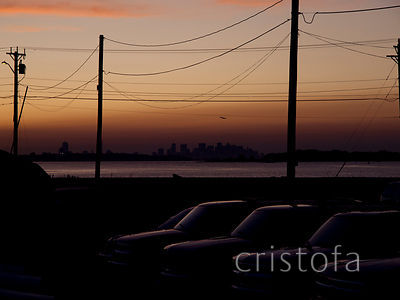 the Boston skyline at sundown from Hull, Mass