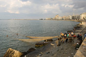 Fishermen bringing in nets, Waterfront at the Mediterranian sea, Alexandria, Egypt