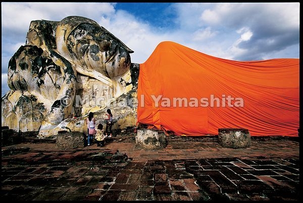 The reclining Buddha at Wat Lokaya Sutha in Ayutthaya is covered in new saffron robes on Buddha's birthday each year.