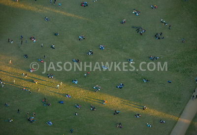 Aerial view of London, close up of people sitting in Hyde Park.