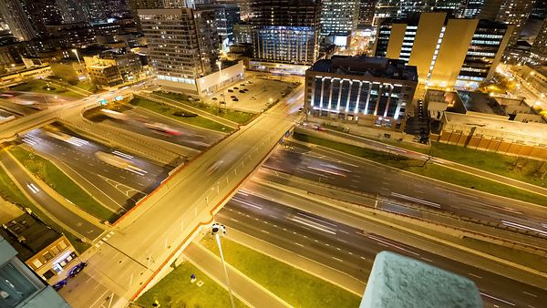 Bird's Eye: Super Wide Shot of Chicago Skyline With Busy Highway Foreground