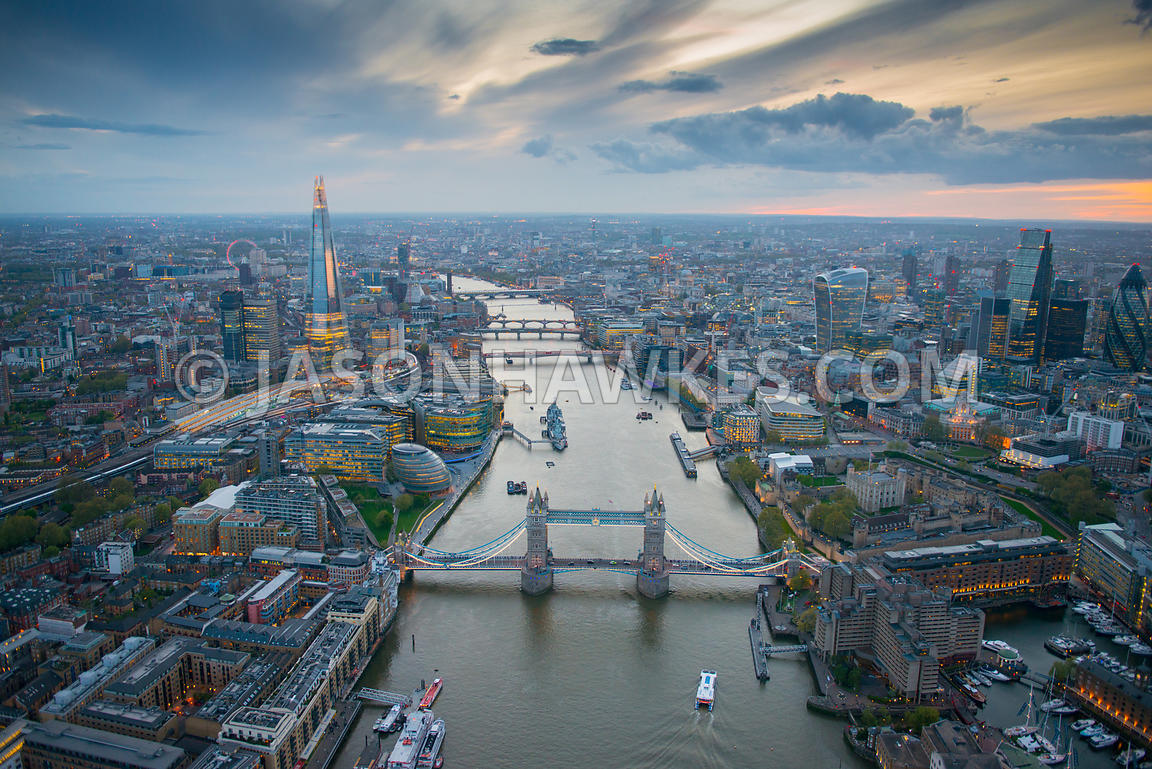 Aerial view of London, Tower Bridge, River Thames and City of London at dusk.