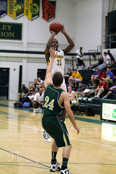 Cedar Rapids Kennedy's Josiah Coleman (35) shoots a jumper over Iowa CIty West's Jake Gylten (24) in the first half of play. ...