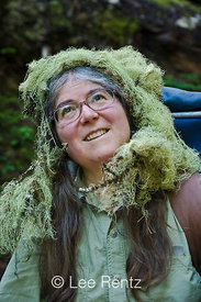 "Karen Rentz with Usnea lichen (Usnea longissima) ""hair"" in the Perry Creek Research Natural Area of Mt. Baker-Snoqualmie Nati..."
