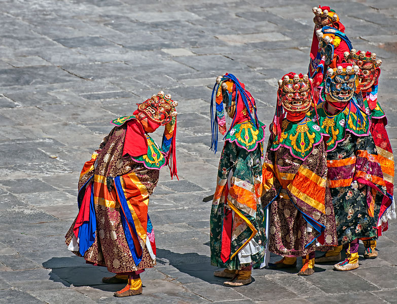 Folk Dancers line up to perform a mask dance during the Thimphu festival. This photograph was shot in a monastery in Bhutan.