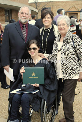 Young woman in a wheelchair on her graduation day.