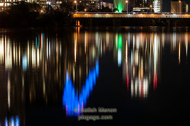 Austin Downtown Lights at Night, with reflection in Colorado River, Texas, USA